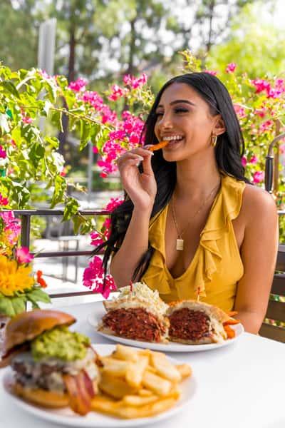 Girl eating bacon cheeseburger