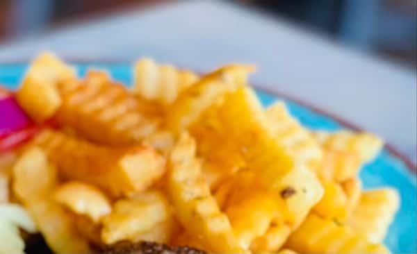 Crinkle Cut fries seasoned with house seasoning