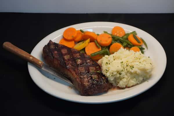Strip steak with mash and veg