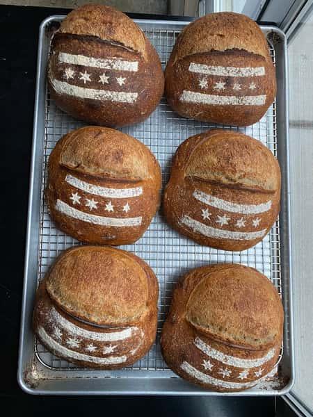 sourdough bread with stencil flour designs