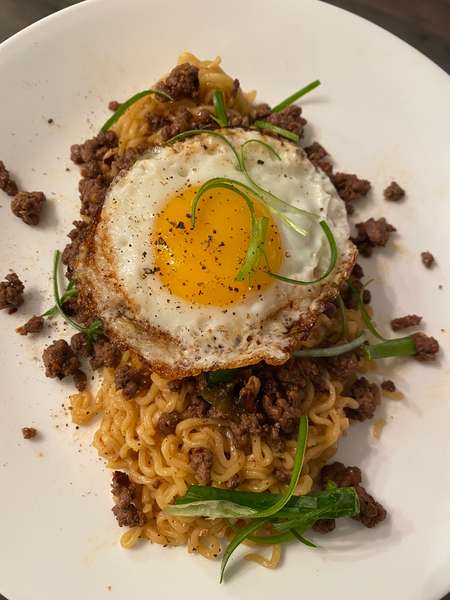 noodle entree with fried egg