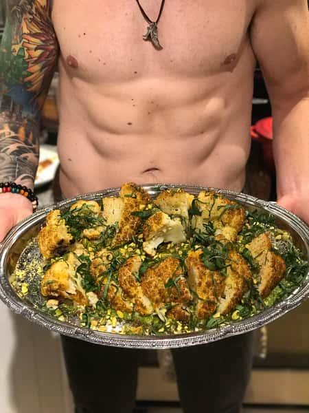 nude dude serving food