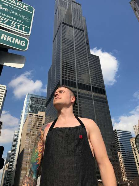 nude dude in front of sky scraper