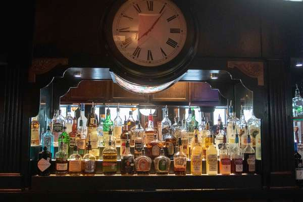 Bar and tap with a large clock
