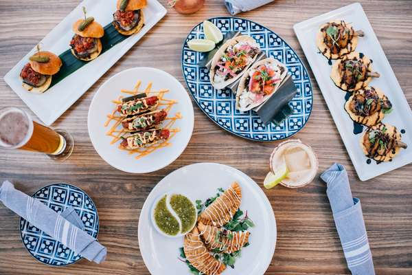Multiple dishes made at Mad Chef Kitchen & Bar