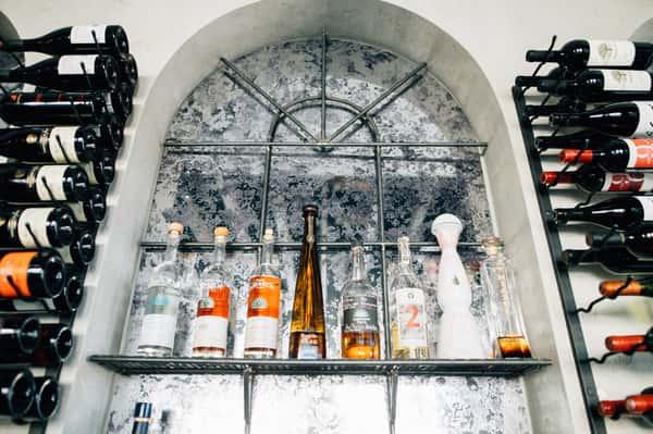 Interior window with different wine bottles surrounding it on racks