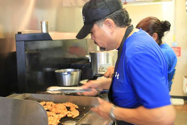Jesse Ocana cooking in the kitchen at the taqueria