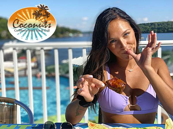 woman eating chicken wing