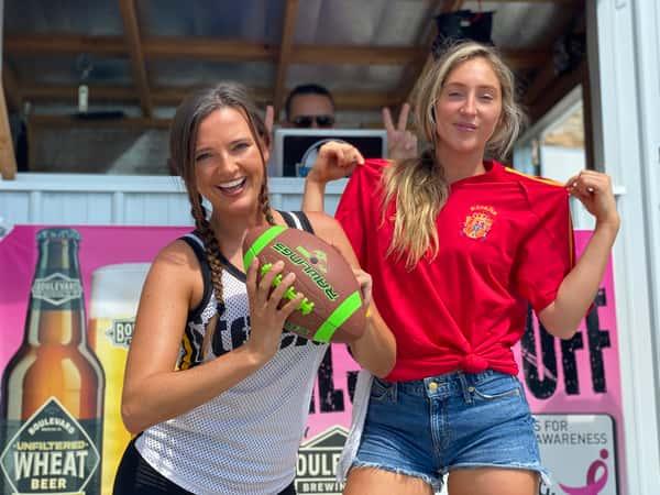 women holding football