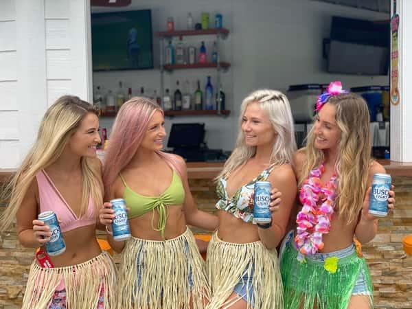 women in hula skirts