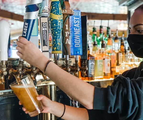 server filling beer glass