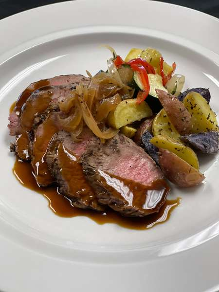 Grilled Sliced Beef with mushroom red wine reduction
