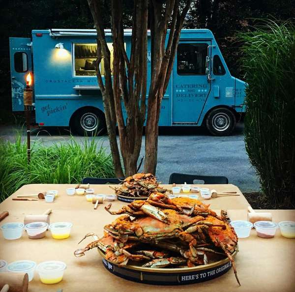 crabs with crab truck in back