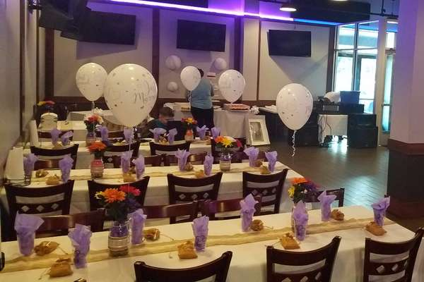 rows of tables set for a party