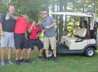 four people and golf cart