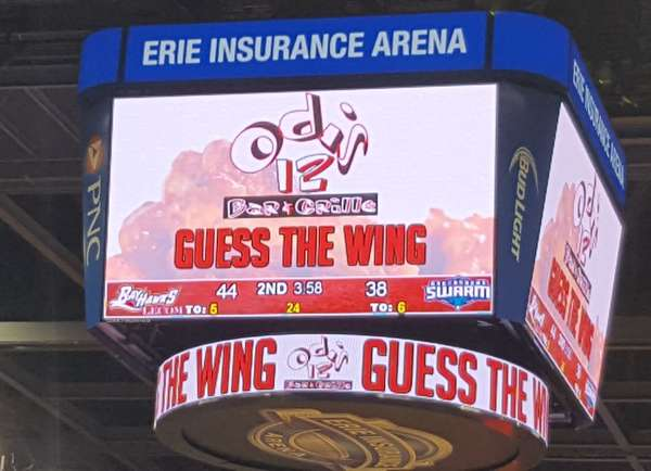 """store logo and """"guess the wing"""" shown on a scoreboard"""