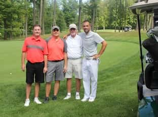 four people on golf course