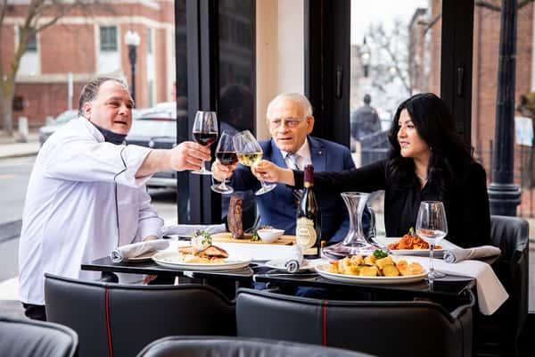 three people enjoying food