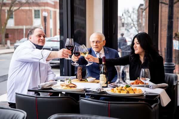 three people dining