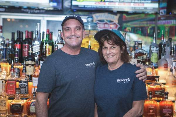 couple behind bar