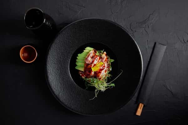 Avocado & Ham Tartare: Thinly sliced avocado, ham, herbs with soy glaze.