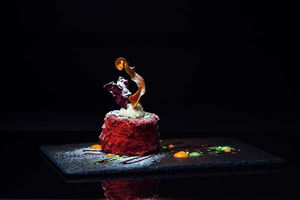 Red Velvet: Magestic, moist red velvet cake served with an assortment of dehydrated fruits and sweet sauces