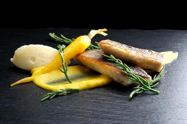 Pan-roasted seabass on yellow carrot puree