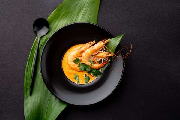 Prawn Curry: Whole prawns immersed in a yellow curry.