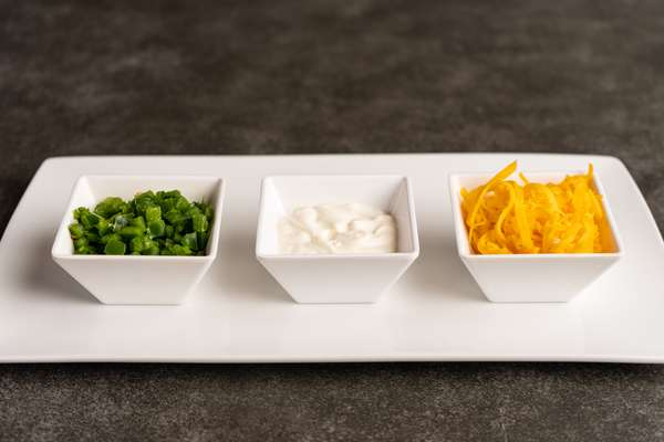 Sides of Jalepenos-Crema-Cheese on Plate