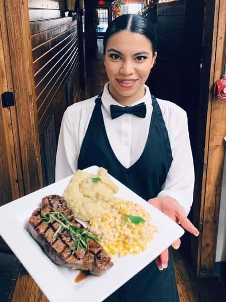 woman server holding steak