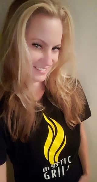 girl wearing mystic grill shirt