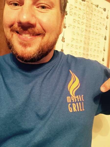 Guy with Mystic Grill shirt