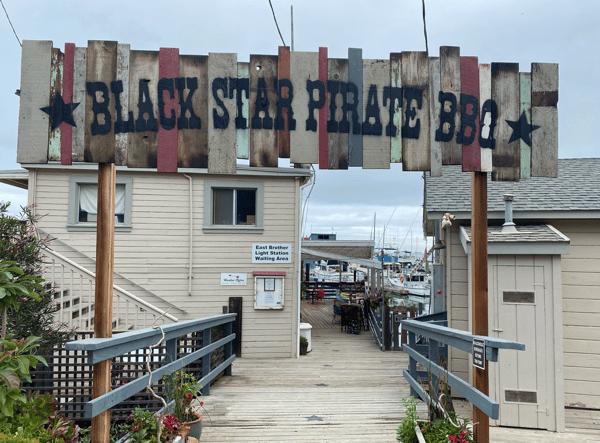 Black Star Pirate BBQ sign