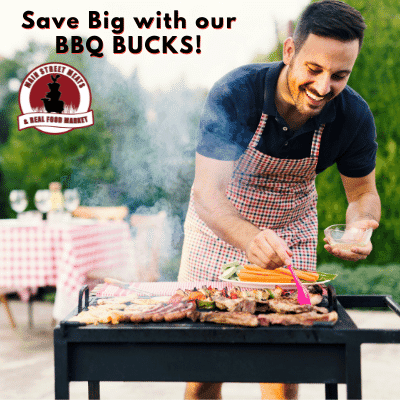 Guy smiling while barbecuing