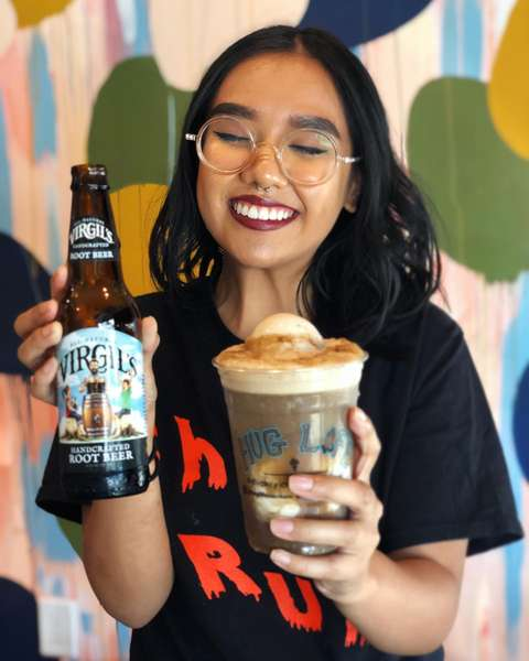 Woman enjoying a Virgil's root beer float