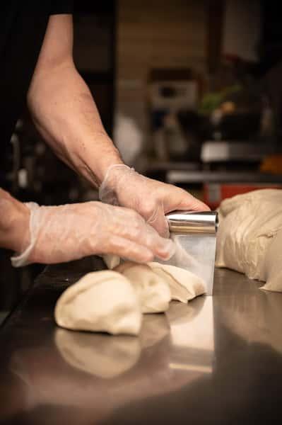 chef cutting dough