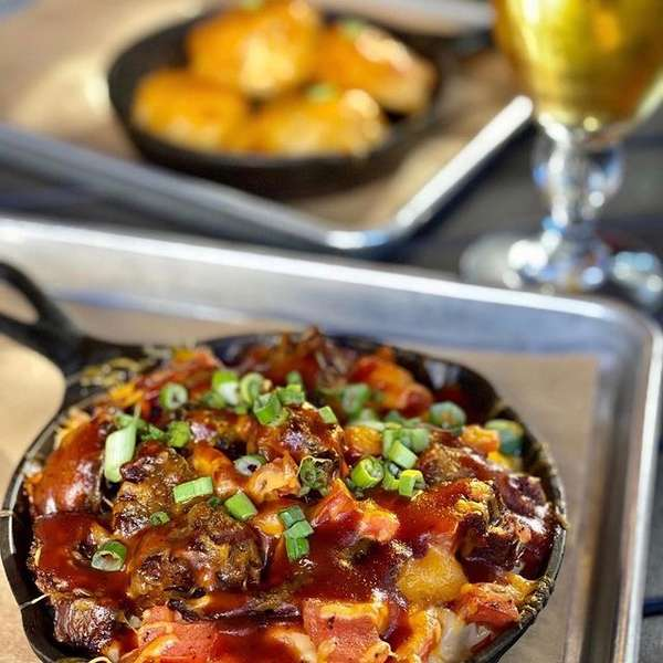 cheesy food baked in a skillet