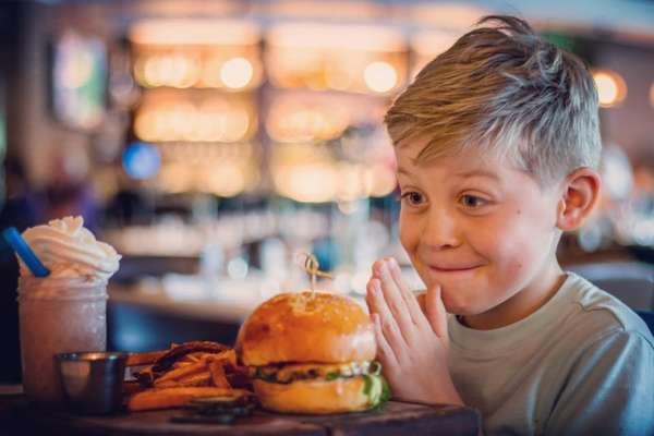 child with burger and fries
