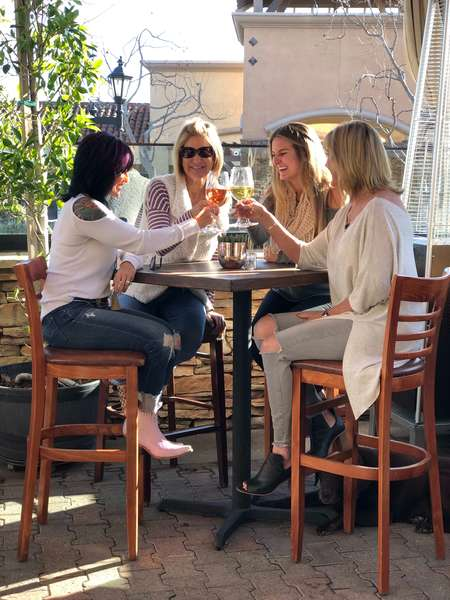 women on patio