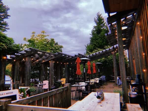Exterior outdoor dining at Cafe Arta & Pub at Third Place