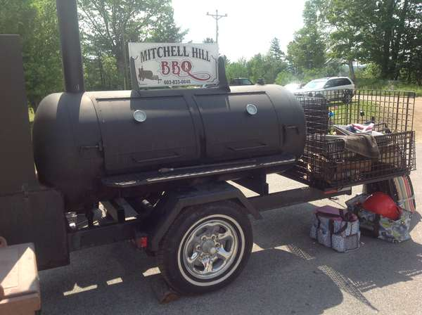 """Bob and """"Uncle"""" built this portable smoker in 2009. It houses a smoker, grill and steamer. This is where it all began. We started our catering business in the spring of 2010."""