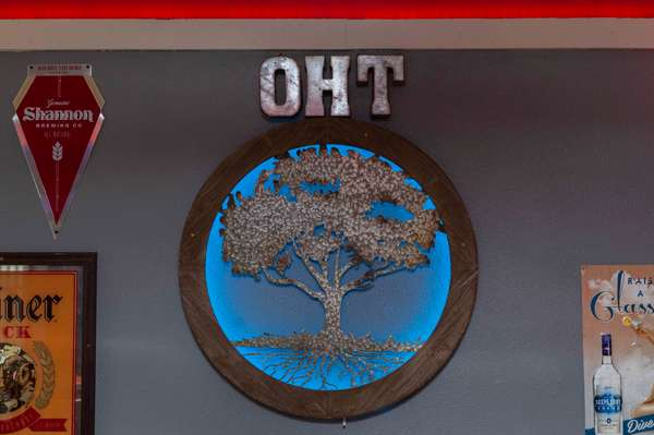 Interior of Oak Hills Taverns logo sign