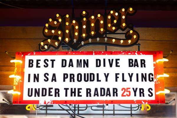 Sign that says best damn dive bar in San Antonio proudly flying under the radar 25 years