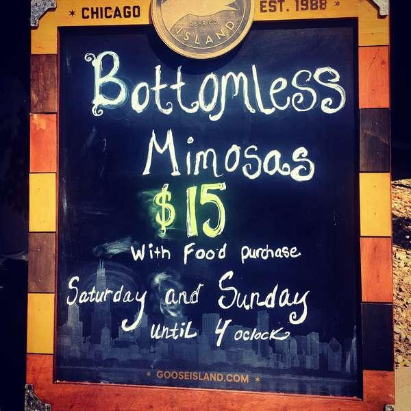 chalk board sign bottomless mimosas $15 with food purchase