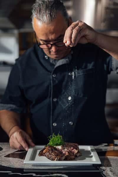chef salting food