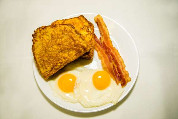 2 slices of French toast (white, wheat, rye, vienna, sweet bread) or 2 pancakes w/2 eggs and choice of bacon, ham, sausage