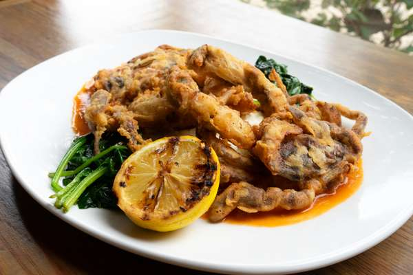 Soft shell crab with gouda grits, sautéed spinach, and a tomato caper butter sauce