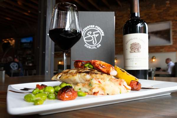 Grilled red snapper with lobster mashed potatoes, blistered tomato, and edamame
