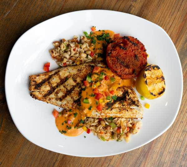 Cajun Grilled Redfish over Hoppin-john and Roasted Tomato with Andouille Cream Sauce