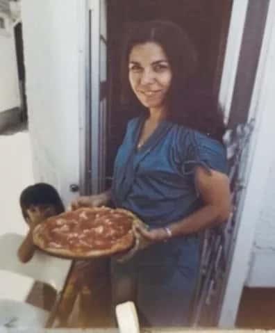 Mrs. Fuccio holding a homemade pizza